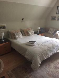 Een bed of bedden in een kamer bij B&B Estee