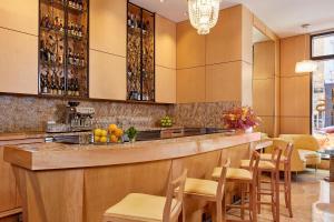 A kitchen or kitchenette at Orchard Garden Hotel