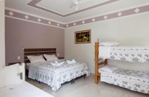 Cama ou camas em um quarto em Pousada Igarapé