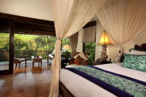 A bed or beds in a room at Warwick Ibah Luxury Villas & Spa