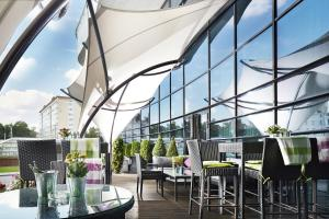A restaurant or other place to eat at Renaissance Minsk Hotel