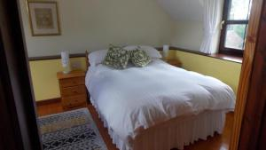 A bed or beds in a room at The Granary Roadside Farm
