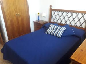 A bed or beds in a room at Burrero Seasight