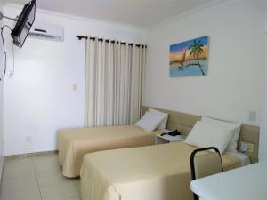 Кровать или кровати в номере Simas Praia Hotel