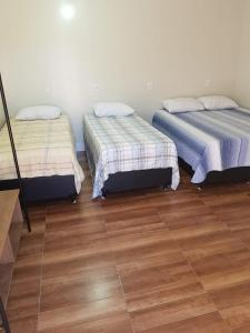 A bed or beds in a room at Estância Flamarion