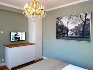 A television and/or entertainment center at Apartments van Leyden