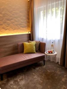Ein Sitzbereich in der Unterkunft Hotel Am Park