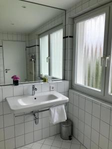 Ein Badezimmer in der Unterkunft Hotel Am Park