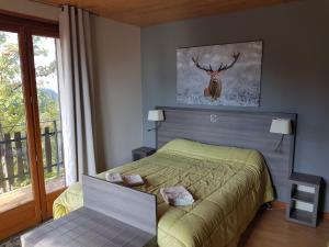 Ліжко або ліжка в номері Hôtel Les Chamois