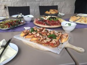 Mittag- und/oder Abendessen für Gäste der Unterkunft Guest House Villa Maslina Neum