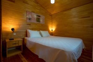 Кровать или кровати в номере Baraka House