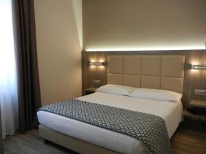 Letto o letti in una camera di Delle Nazioni Milan Hotel