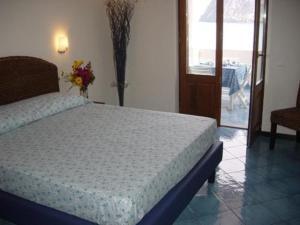 Letto o letti in una camera di Oltremare Residence Hotel