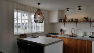 A kitchen or kitchenette at INTIKA Beach House