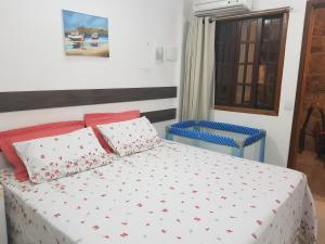 A bed or beds in a room at Residencial Santa Teresa