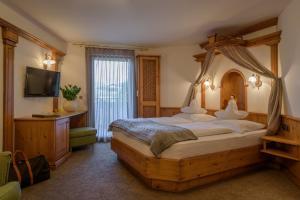 Letto o letti in una camera di Hotel Gasthof Zum Mohren