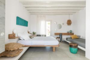 A bed or beds in a room at A Hotel Mykonos