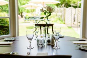A restaurant or other place to eat at Corinium Hotel & Restaurant