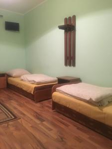 Łóżko lub łóżka w pokoju w obiekcie Górski Ośrodek Wczasowy Kościelec