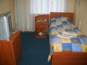 Кровать или кровати в номере Гостиница Утес
