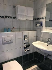 Ein Badezimmer in der Unterkunft Hotel Luxer