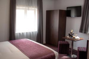 TV/Unterhaltungsangebot in der Unterkunft Hotel Luxer