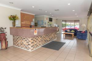 The lobby or reception area at Club Inn Motel