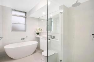 A bathroom at Modern 2BR Apartment with Views HARIS
