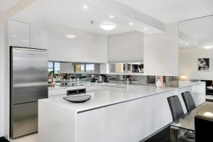 A kitchen or kitchenette at Modern 2BR Apartment with Views HARIS