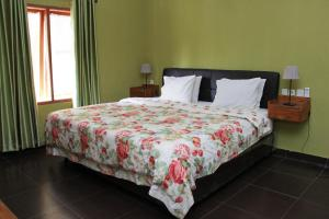 A bed or beds in a room at The Swarna Hotel