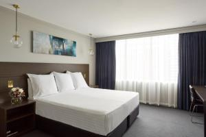 A bed or beds in a room at Bayview Eden Melbourne