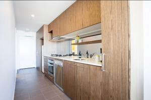 A kitchen or kitchenette at Canvas Suites on William