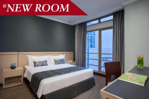 A bed or beds in a room at Somerset Grand Citra Jakarta