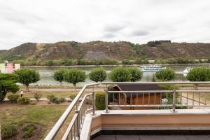 A balcony or terrace at Hotel Villa am Rhein