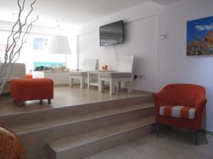 A seating area at Les Palmiers Beach Boutique Hotel & Luxury Apartments