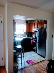 A kitchen or kitchenette at Pleasant Place Rooms