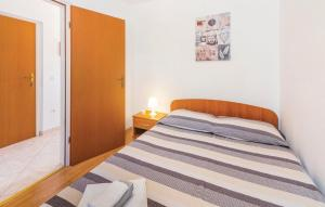 A bed or beds in a room at Apartment Rabac