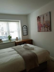 A bed or beds in a room at Bridge Street
