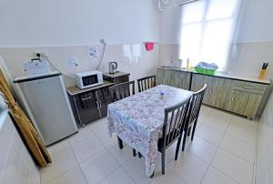 A kitchen or kitchenette at HITS Homestay