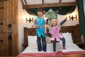 A family staying at Warwick Castle Knight's Village