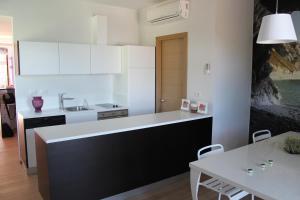 A kitchen or kitchenette at Affittacamere Le Fontanelle