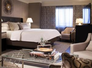 A bed or beds in a room at The Melrose Georgetown Hotel