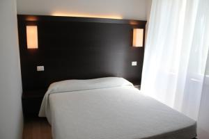 A bed or beds in a room at Affittacamere Le Fontanelle