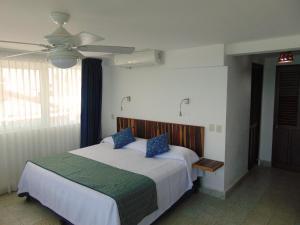 Cama o camas de una habitación en Hotel Rosita
