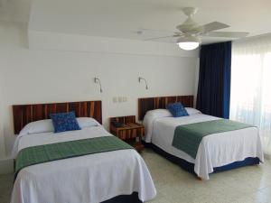 A bed or beds in a room at Hotel Rosita