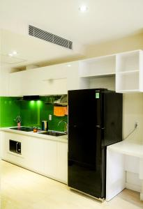 A kitchen or kitchenette at Sunny Serviced Apartment