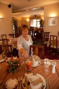 A restaurant or other place to eat at Hanora's Cottage Guesthouse and Restaurant