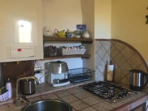 A kitchen or kitchenette at Residenza La Torre