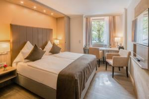 Cama o camas de una habitación en Best Western Plus Hotel Regence