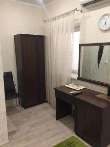 Телевизор и/или развлекательный центр в Гостевой Дом Михалыч